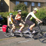 Graham, Joanna and Harriet Pike on an uncommon three-seat-tandem.